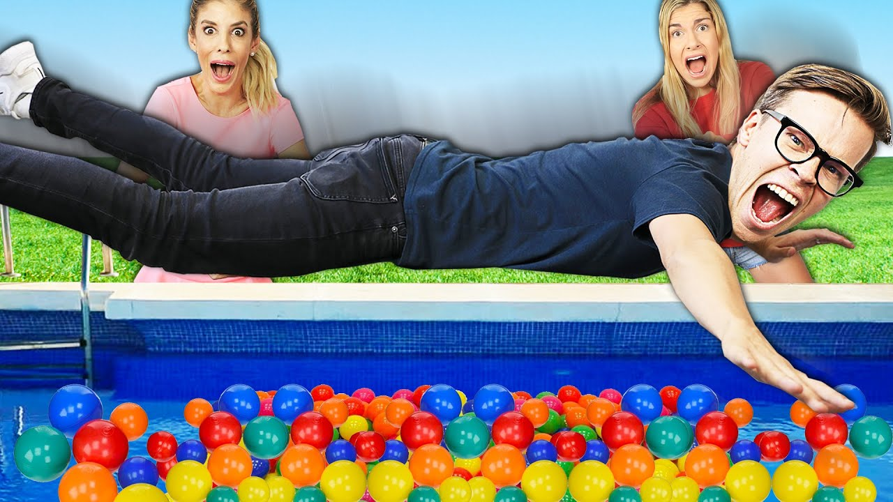 Filling our ENTIRE POOL with Ball Pit Balls for FACE REVEAL! Bad Idea